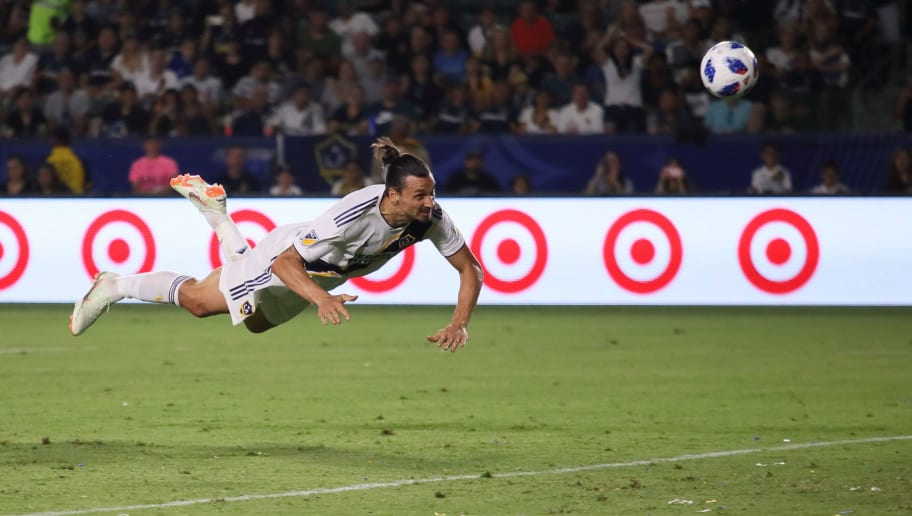 CARSON, CA - JULY 29: Zlatan Ibrahimovic of LA Galaxy scores a goal with a diving header to make it 3-3 during the MLS match between LA Galaxy and Orlando City at StubHub Center on July 29, 2018 in Carson, California. (Photo by Matthew Ashton - AMA/Getty Images)