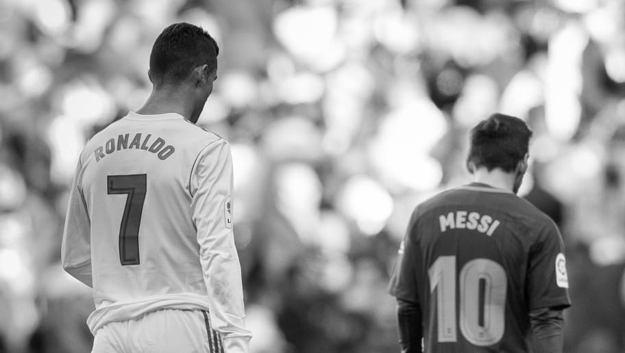 MADRID, SPAIN - DECEMBER 23: Lionel Messi of FC Barcelona and Cristiano Ronaldo of Real Madrid walk off pitch during La Liga match between Real Madrid and FC Barcelona at Santiago Bernabeu stadium on December 23, 2017 in Madrid, Spain. (Photo by Power Sport Images/Getty Images)