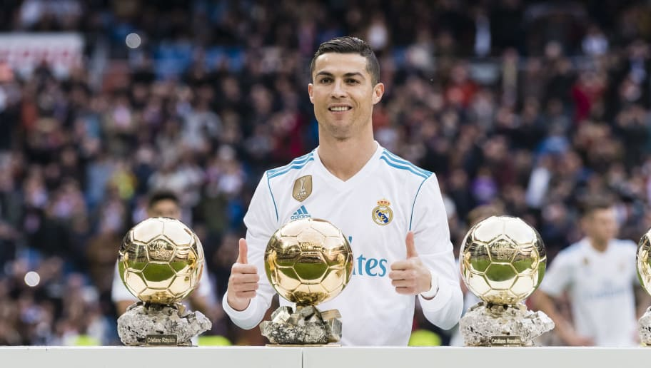 MADRID, SPAIN - DECEMBER 09: Cristiano Ronaldo of Real Madrid poses for photos with his FIFA Ballon Dor Trophies prior to the La Liga 2017-18 match between Real Madrid and Sevilla FC at Santiago Bernabeu Stadium on 09 December 2017 in Madrid, Spain. (Photo by Power Sport Images/Getty Images)
