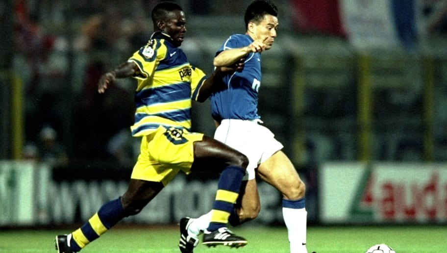 25 Aug 1999:  Lasiev Lassissi of Parma and Michael Mols of Rangers in action during the Champions'' League, Third Round, Second Leg match between Parma and Rangers at Ennio Tardini Stadium, Parma, Italy. Parma won the game 1-0, but Rangers progressed winning with a 2-1 aggregate score. \ Mandatory Credit: Clive Brunskill /Allsport