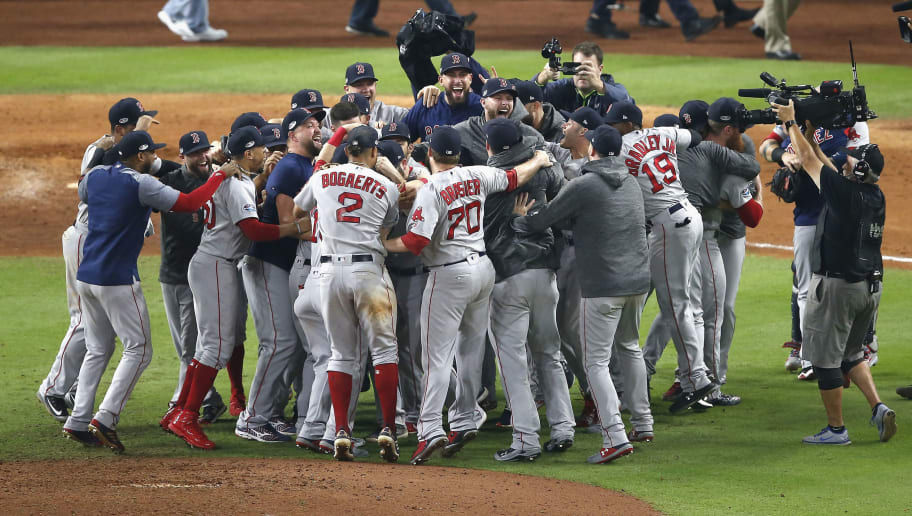HOUSTON, TX - OCTOBER 18:  Boston Red Sox celebrate defeating the Houston Astros clinching the division in Game Five of the American League Championship Series at Minute Maid Park on October 18, 2018 in Houston, Texas.  (Photo by Tim Warner/Getty Images)