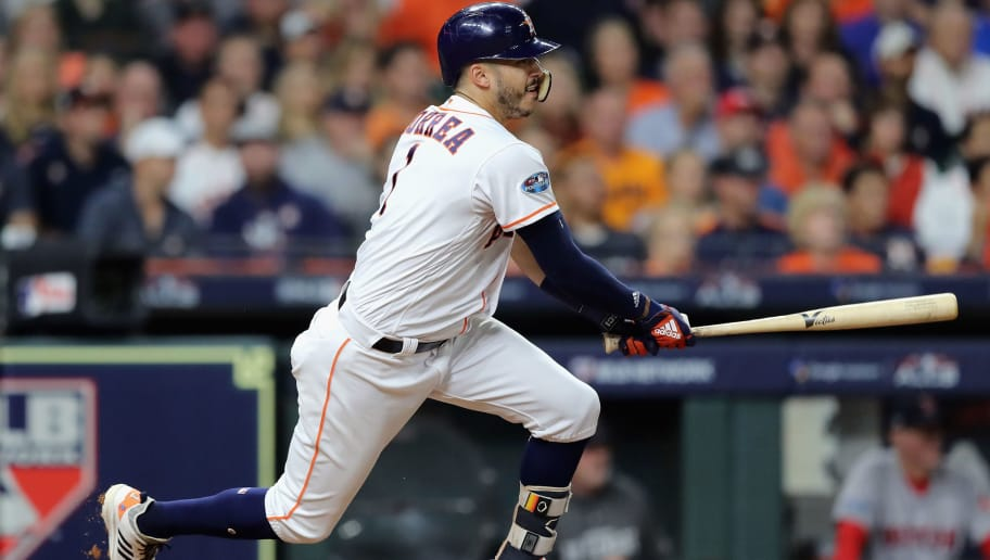 HOUSTON, TX - OCTOBER 17:  Carlos Correa #1 of the Houston Astros hits a RBI single in the second inning against the Boston Red Sox during Game Four of the American League Championship Series at Minute Maid Park on October 17, 2018 in Houston, Texas.  (Photo by Elsa/Getty Images)