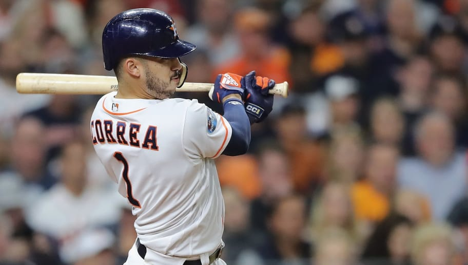 HOUSTON, TX - OCTOBER 17:  Carlos Correa #1 of the Houston Astros hits a RBI single in the fifth inning against the Boston Red Sox during Game Four of the American League Championship Series at Minute Maid Park on October 17, 2018 in Houston, Texas.  (Photo by Elsa/Getty Images)
