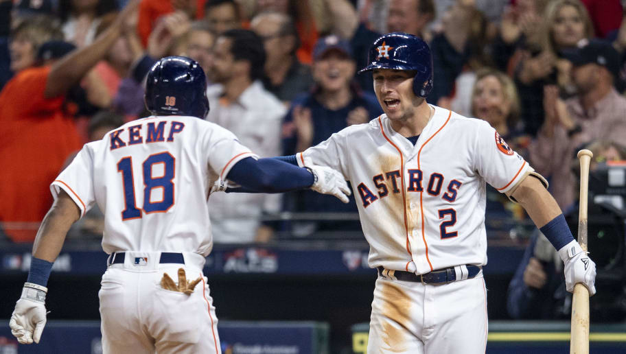 HOUSTON, TX - OCTOBER 17: Tony Kemp #18 of the Houston Astros reacts with Alex Bregman #2 after hitting a solo home run during Game 4 of the ALCS against the Boston Red Sox at Minute Maid Park on Wednesday, October 17, 2018 in Houston, Texas. (Photo by Billie Weiss/Boston Red Sox/Getty Images)
