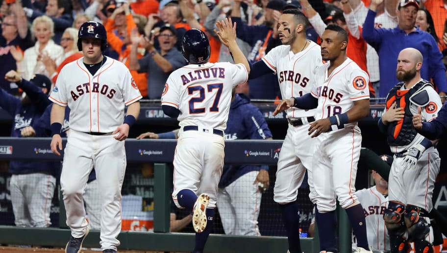 HOUSTON, TX - OCTOBER 16:  Jose Altuve #27 of the Houston Astros celebrates at the dugout after scoring a run in the fifth inning against the Boston Red Sox during Game Three of the American League Championship Series at Minute Maid Park on October 16, 2018 in Houston, Texas.  (Photo by Elsa/Getty Images)