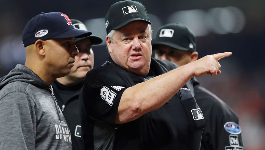 HOUSTON, TX - OCTOBER 16:  Manager Alex Cora of the Boston Red Sox talks with umpire Joe West before Game Three of the American League Championship Series between the Boston Red Sox and the Houston Astros at Minute Maid Park on October 16, 2018 in Houston, Texas.  (Photo by Elsa/Getty Images)