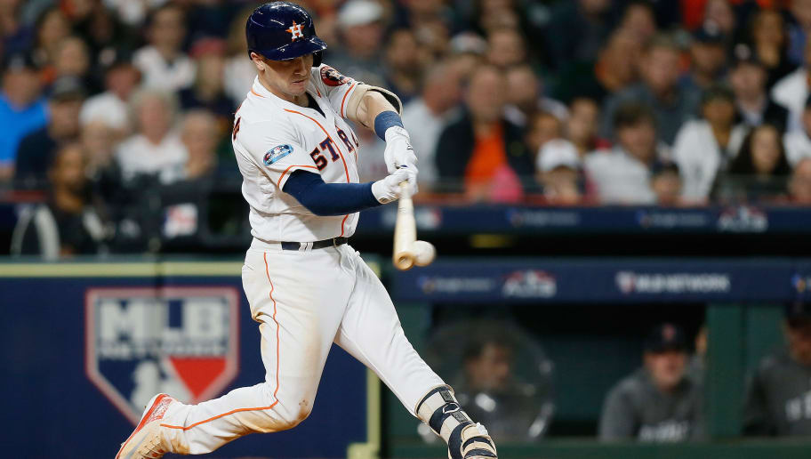 HOUSTON, TX - OCTOBER 16:  Alex Bregman #2 of the Houston Astros hits a RBI double in the fifth inning against the Boston Red Sox during Game Three of the American League Championship Series at Minute Maid Park on October 16, 2018 in Houston, Texas.  (Photo by Bob Levey/Getty Images)