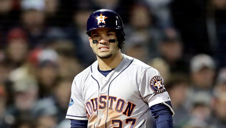 BOSTON, MA - OCTOBER 13:  Jose Altuve #27 of the Houston Astros hits the dirt off his cleats during the fifth inning against the Boston Red Sox in Game One of the American League Championship Series at Fenway Park on October 13, 2018 in Boston, Massachusetts.  (Photo by Elsa/Getty Images)