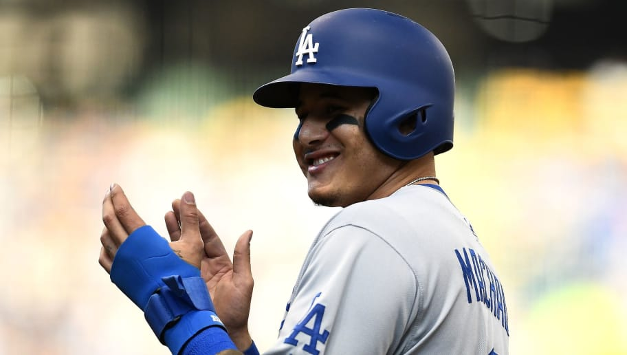 MILWAUKEE, WI - OCTOBER 13:  Manny Machado #8 of the Los Angeles Dodgers celebrates after hitting a single against the Milwaukee Brewers during the seventh inning in Game Two of the National League Championship Series at Miller Park on October 13, 2018 in Milwaukee, Wisconsin.  (Photo by Stacy Revere/Getty Images)