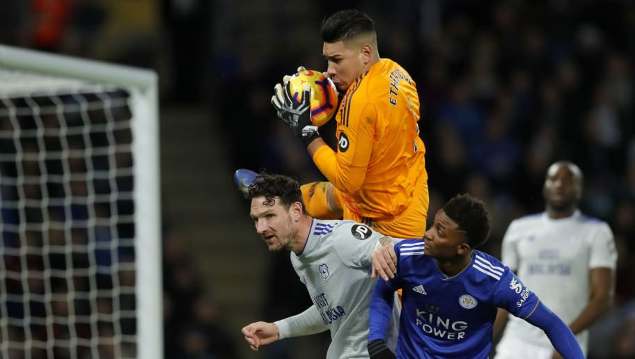 LEICESTER, ENGLAND - DECEMBER 29: Cardiff City goalkeeper Neil Etheridge catches the ball under pressure from Sean Morrison (L) and Demarai Gray during the Premier League match between Leicester City and Cardiff City at The King Power Stadium on December 29, 2018 in Leicester, United Kingdom. (Photo by Malcolm Couzens/Getty Images)