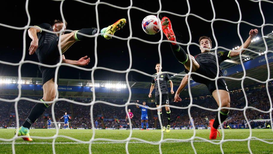 LEICESTER, ENGLAND - SEPTEMBER 20:  Cesar Azpilicueta of Chelsea (R) and Gary Cahill of Chelsea (L) attempt to stop the ball crossing the line as Shinji Okazaki of Leicester City scores his sides first goal during the EFL Cup Third Round match between Leicester City and Chelsea at The King Power Stadium on September 20, 2016 in Leicester, England.  (Photo by Julian Finney/Getty Images)
