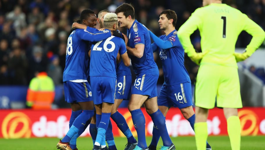 LEICESTER, ENGLAND - JANUARY 01:  Islam Slimani of Leicester City (blocked) is congratulated by team mates as he celebrates scoring his team's second goal during the Premier League match between Leicester City and Huddersfield Town at The King Power Stadium on January 1, 2018 in Leicester, England.  (Photo by Clive Mason/Getty Images)