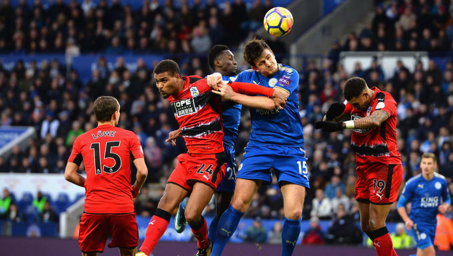 LEICESTER, ENGLAND - JANUARY 01:  Harry Maguire of Leicester City wins the ball from Steve Mounie of Huddersfield Town during the Premier League match between Leicester City and Huddersfield Town at The King Power Stadium on January 1, 2018 in Leicester, England.  (Photo by Tony Marshall/Getty Images)