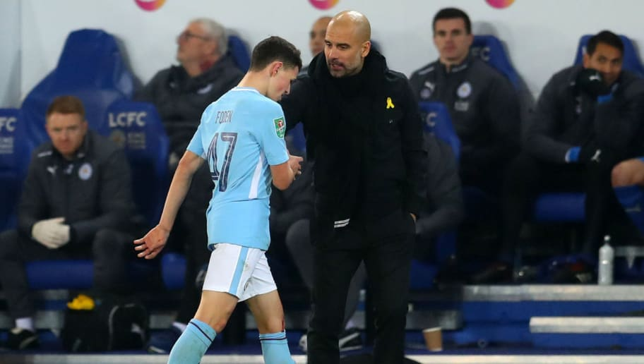 LEICESTER, ENGLAND - DECEMBER 19: Pep Guardiola the head coach / manager of Manchester City and Phil Foden of Manchester City during the Carabao Cup Quarter-Final match between Leicester City and Manchester City at The King Power Stadium on December 19, 2017 in Leicester, England. (Photo by Catherine Ivill/Getty Images)