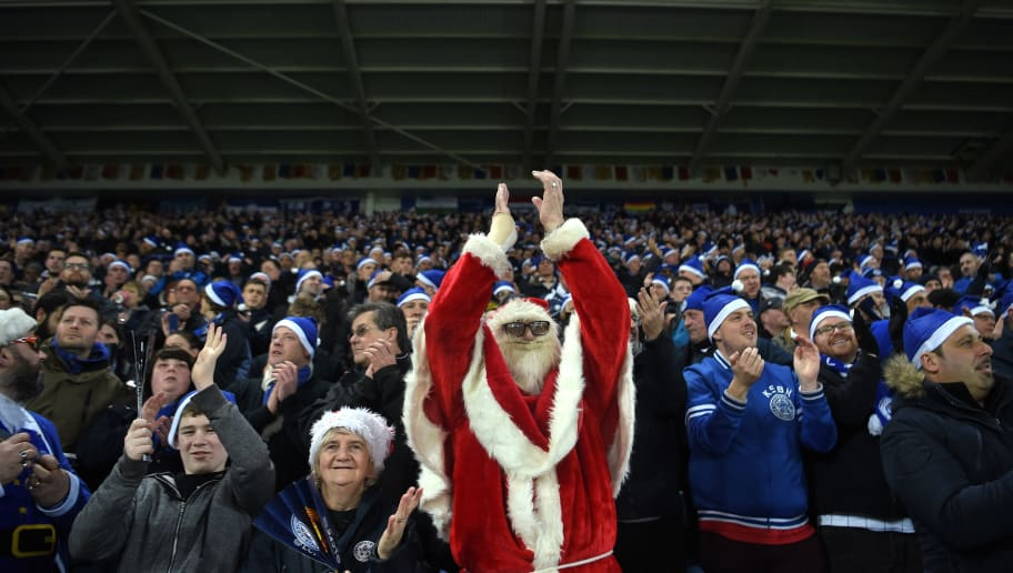 LEICESTER, ENGLAND - DECEMBER 23:  A Leicester City fan dressed as Father Christmas applauds during the Premier League match between Leicester City and Manchester United at The King Power Stadium on December 23, 2017 in Leicester, England.  (Photo by Michael Regan/Getty Images)