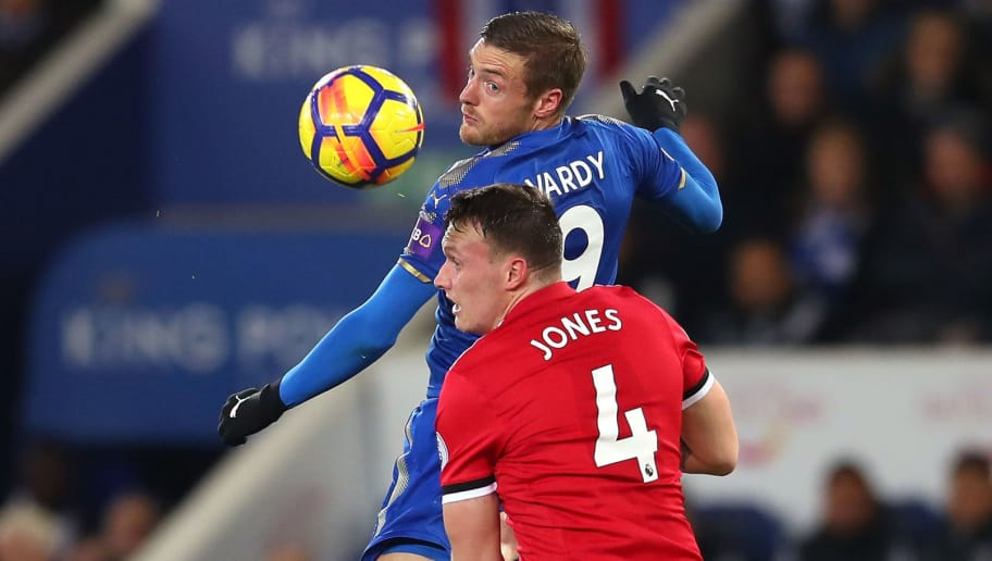 LEICESTER, ENGLAND - DECEMBER 23:  Jamie Vardy of Leicester City is challenged by Phil Jones of Manchester United during the Premier League match between Leicester City and Manchester United at The King Power Stadium on December 23, 2017 in Leicester, England.  (Photo by Catherine Ivill/Getty Images)