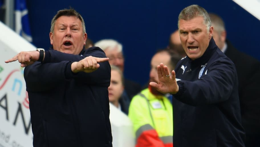 LEICESTER, ENGLAND - MAY 02: Nigel Pearson (R), manager of Leicester City and Craig Shakespeare (L), Assistant Manager of Leicester City gesture during the Barclays Premier League match between Leicester City and Newcastle United at The King Power Stadium on May 2, 2015 in Leicester, England.  (Photo by Ross Kinnaird/Getty Images)