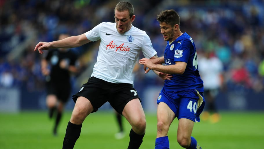 LEICESTER, ENGLAND - MAY 24:  Richard Dunne of QPR holds of Andrej Kramaric of Leicester City during the Premier League match between Leicester City and Queens Park Rangers at The King Power Stadium on May 24, 2015 in Leicester, England.  (Photo by Dan Mullan/Getty Images)