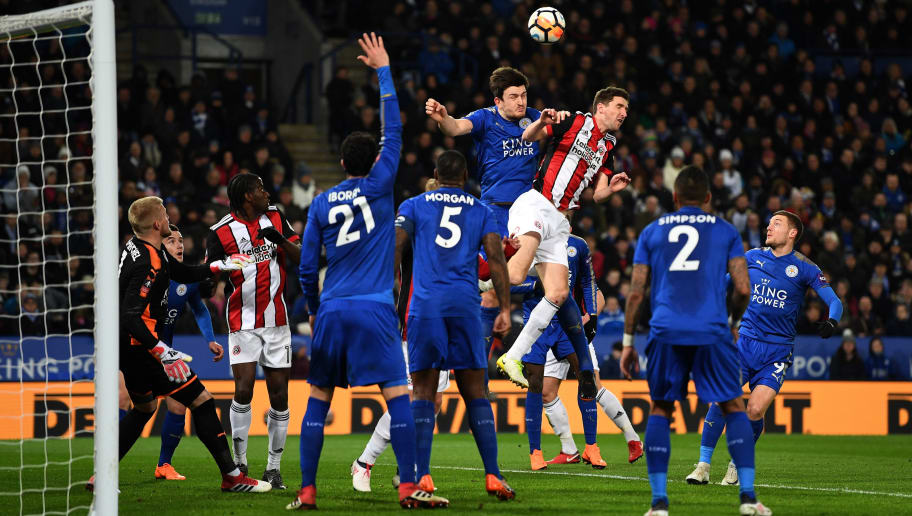 LEICESTER, ENGLAND - FEBRUARY 16:  Harry Maguire of Leicester and Chris Basham of Sheffield battle in the air during The Emirates FA Cup Fifth Round match between Leicester City and Sheffield United  at The King Power Stadium on February 16, 2018 in Leicester, England.  (Photo by Michael Regan/Getty Images)