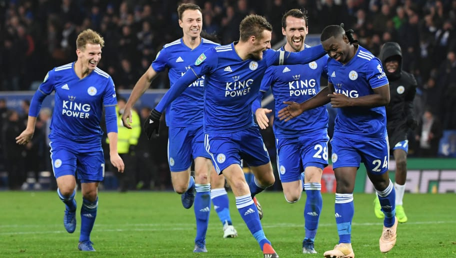 LEICESTER, ENGLAND - NOVEMBER 27:  Nampalys Mendy of Leicester City celebrates with Jamie Vardy, Christian Fuchs and their team mates after scoring a penalty during a penalty shoot out during the Carabao Cup Fourth Round match between Leicester City and Southampton at The King Power Stadium on November 27, 2018 in Leicester, England.  (Photo by Ross Kinnaird/Getty Images)
