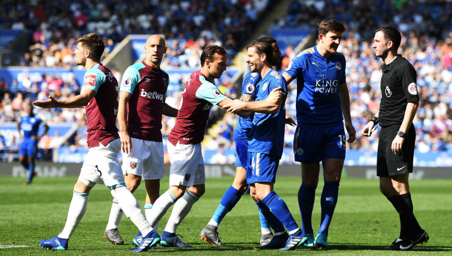 LEICESTER, ENGLAND - MAY 05:  Aaron Cresswell of West Ham United and Adrien Silva of Leicester City clash during the Premier League match between Leicester City and West Ham United at The King Power Stadium on May 5, 2018 in Leicester, England.  (Photo by Michael Regan/Getty Images)