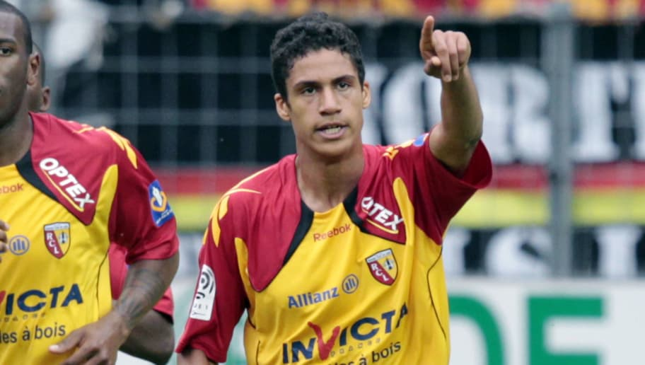 Lens' defender Raphaël Varane (R) celebrates team-mates after scoring a goal during their French L1 football match Caen vs Lens on May 07, 2011 at the Michel d'Ornano stadium in Caen, northwestern France. AFP PHOTO KENZO TRIBOUILLARD (Photo credit should read KENZO TRIBOUILLARD/AFP/Getty Images)