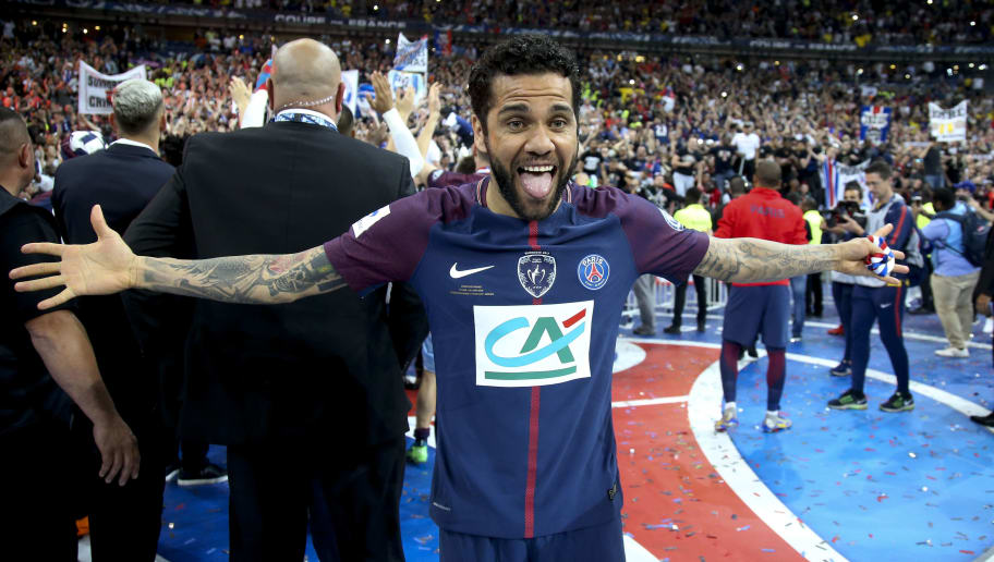 PARIS, FRANCE - MAY 8: Dani Alves aka Daniel Alves celebrates the victory following the French Cup final (Coupe de France) between Les Herbiers VF and Paris Saint-Germain (PSG) at Stade de France on May 8, 2018 in Saint-Denis near Paris, France. (Photo by Jean Catuffe/Getty Images)