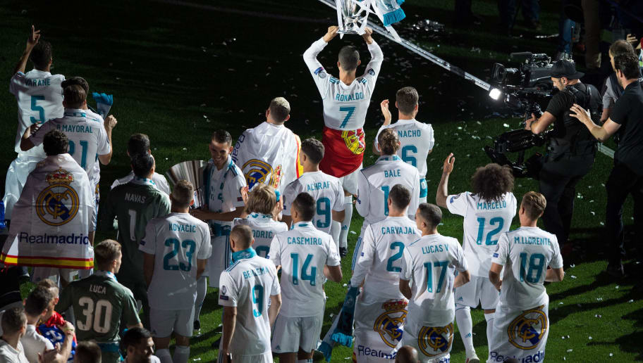 MADRID, SPAIN - MAY 27: Cristiano Ronaldo of Real Madrid celebrates with teammates during celebrations at the Santiago Bernabeu stadium following their victory last night in Kiev in the UEFA Champions League final, on May 27, 2018 in Madrid, Spain. Real beat Liverpool 3-1 in the final to lift the European Cup and Champions League for the 13th time. (Photo by Denis Doyle/Getty Images) (Photo by Denis Doyle/Getty Images)