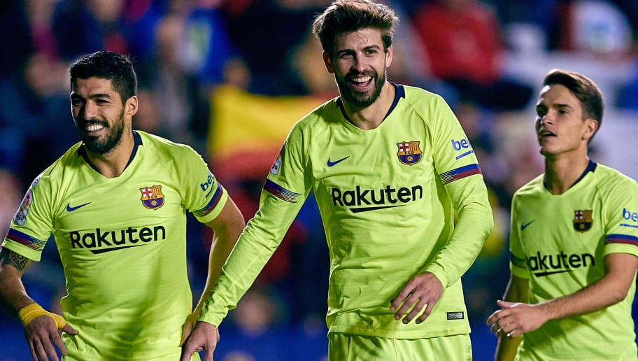 VALENCIA, SPAIN - DECEMBER 16: Gerard Pique (C) of FC Barcelona celebrates his side's fifth goal with his teammates Luis Suarez (L) and Denis Suarez during the La Liga match between Levante UD and FC Barcelona at Ciutat de Valencia on December 16, 2018 in Valencia, Spain. (Photo by David Aliaga/MB Media/Getty Images)