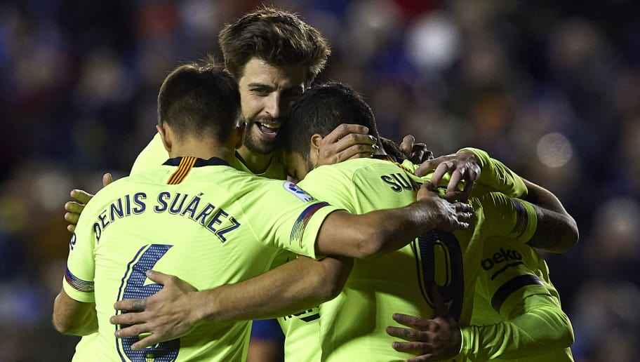 VALENCIA, SPAIN - DECEMBER 16: Gerard Pique of Barcelona celebrates after scoring his sides fifth goal with his teammates during the La Liga match between Levante UD and FC Barcelona at Ciutat de Valencia on December 16, 2018 in Valencia, Spain. (Photo by Quality Sport Images/Getty Images)