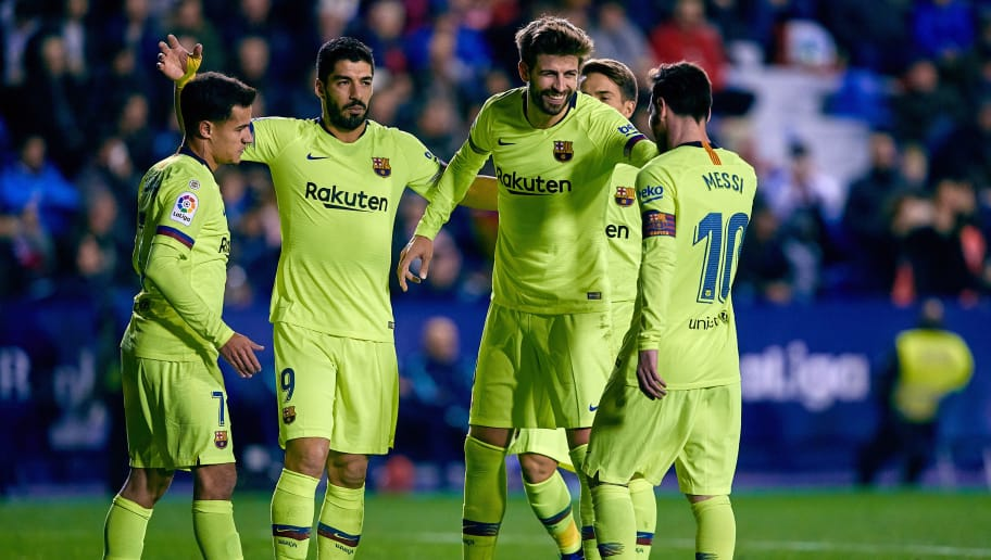 VALENCIA, SPAIN - DECEMBER 16: Gerard Pique (C) of FC Barcelona celebrates his side's fifht goal with his teammates Luis Suarez (L), Lionel Messi (R) and Philippe Coutinho during the La Liga match between Levante UD and FC Barcelona at Ciutat de Valencia on December 16, 2018 in Valencia, Spain. (Photo by David Aliaga/MB Media/Getty Images)