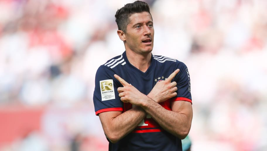 COLOGNE, GERMANY - MAY 05: Robert Lewandowski #9 of Bayern Munich celebrates after scoring a goal to make it 1-2 during the Bundesliga match between 1. FC Koeln and FC Bayern Muenchen at RheinEnergieStadion on May 5, 2018 in Cologne, Germany. (Photo by Maja Hitij/Bongarts/Getty Images)