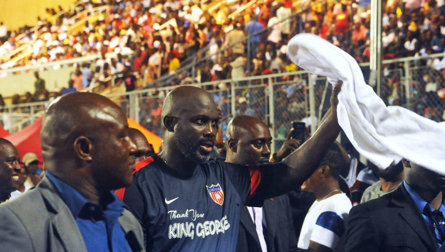 A picture taken on September 11, 2018, shows Liberian president and football legend George Weah (C) acknowledging the crowd after taking part in a friendly football match between Liberia and Nigeria in Monrovia. - Liberia president and former world footballer of the year George Weah made a surprise return to international football on September 11 at the age of 51 in a 2-1 friendly defeat by Nigeria. (Photo by Zoom DOSSO / AFP)        (Photo credit should read ZOOM DOSSO/AFP/Getty Images)