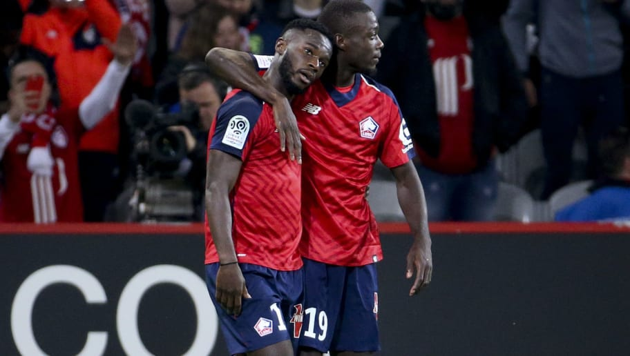 LILLE, FRANCE - SEPTEMBER 30: Jonathan Bamba of Lille celebrates his first goal with Nicolas Pepe during the french Ligue 1 match between Lille OSC (LOSC) and Olympique de Marseille (OM) at Stade Pierre Mauroy on September 30, 2018 in Lille, France. (Photo by Jean Catuffe/Getty Images)