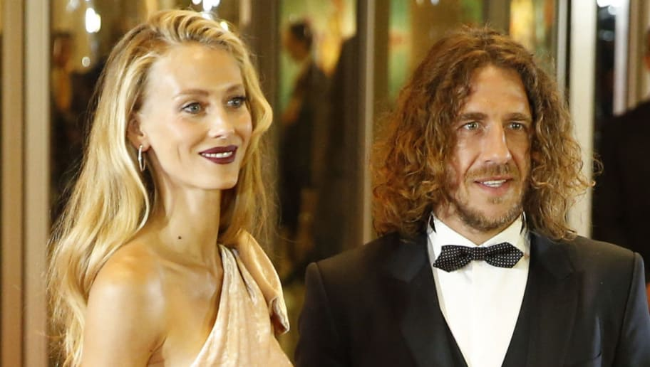 ROSARIO, ARGENTINA - JUNE 30:  Spanish former soccer player Carles Puyol and his wife Vanesa Lorenzo psoe for pictures on the red carpet during Lionel Messi and Antonela Rocuzzo's Wedding at City Center Hotel on June 30, 2017 in Rosario, Argentina. (Photo by Gabriel Rossi/LatinContent/Getty Images)