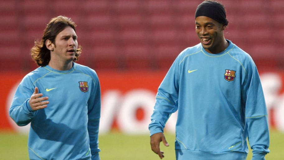 Barcelona's Brazilian midfielder Ronaldinho (R) and Argentinian Leo Messi (L) take part in a training session at the Camp Nou stadium in Barcelona, 06 November 2007 in Barcelona on the eve of their Champions League group E football match against Rangers FC.   AFP PHOTO / LLUIS GENE (Photo credit should read LLUIS GENE/AFP/Getty Images)