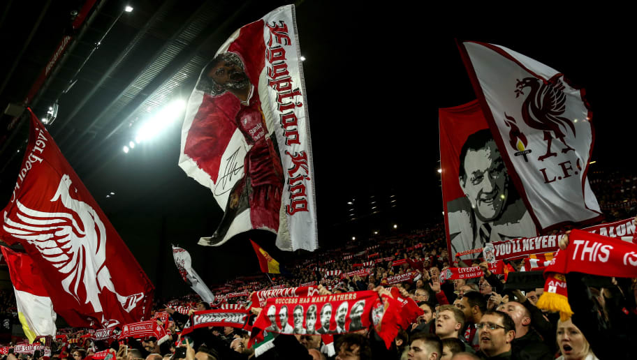 LIVERPOOL, ENGLAND - DECEMBER 29: Fans of Liverpool wave flags and banners during the Premier League match between Liverpool FC and Arsenal FC at Anfield on December 29, 2018 in Liverpool, United Kingdom. (Photo by Robbie Jay Barratt - AMA/Getty Images)