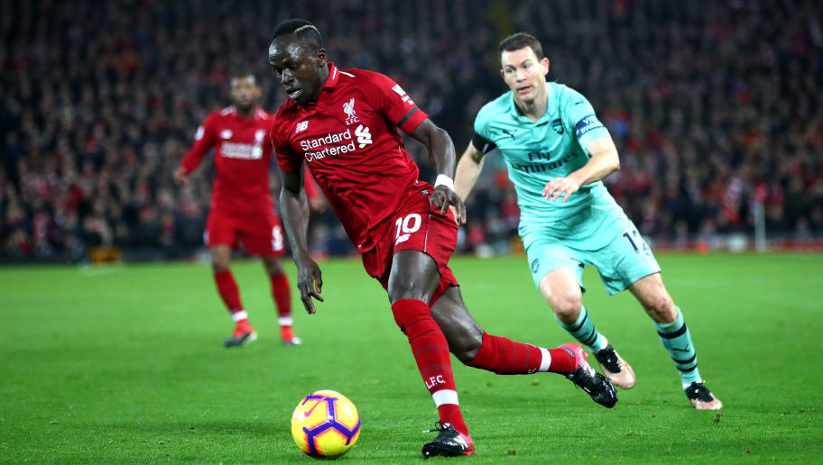 LIVERPOOL, ENGLAND - DECEMBER 29:  Sadio Mane of Liverpool runs with the ball during the Premier League match between Liverpool FC and Arsenal FC at Anfield on December 29, 2018 in Liverpool, United Kingdom.  (Photo by Clive Brunskill/Getty Images)