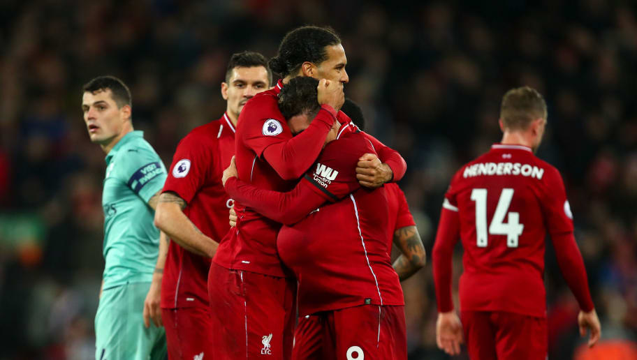 LIVERPOOL, ENGLAND - DECEMBER 29: Roberto Firmino of Liverpool celebrates with Virgil van Dijk of Liverpool at full time during the Premier League match between Liverpool FC and Arsenal FC at Anfield on December 29, 2018 in Liverpool, United Kingdom. (Photo by Robbie Jay Barratt - AMA/Getty Images)