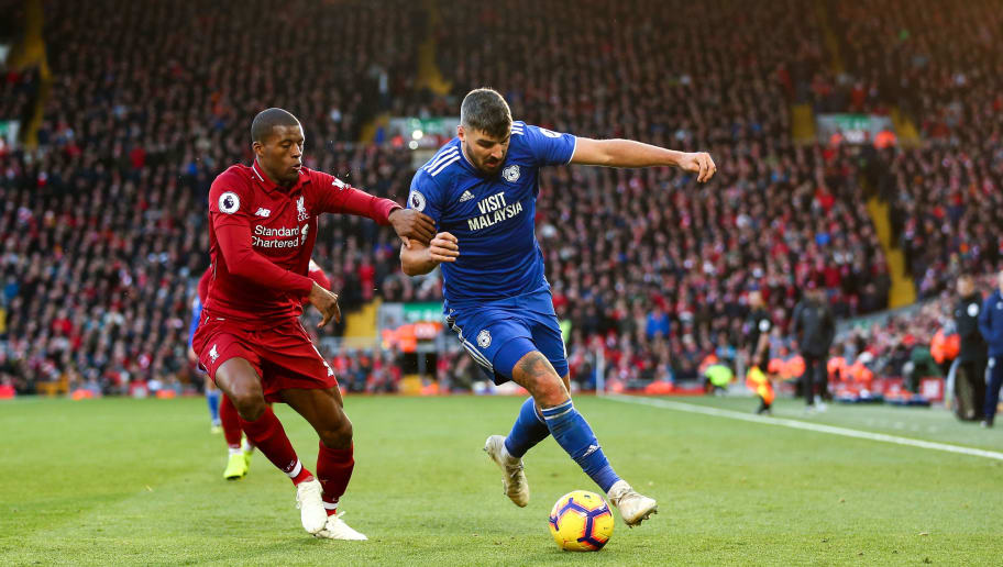 LIVERPOOL, ENGLAND - OCTOBER 27: Georginio Wijnaldum of Liverpool and Callum Paterson of Cardiff City during the Premier League match between Liverpool FC and Cardiff City at Anfield on October 27, 2018 in Liverpool, United Kingdom. (Photo by Robbie Jay Barratt - AMA/Getty Images)