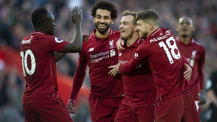 LIVERPOOL, ENGLAND - OCTOBER 27: Xherdan Shaqiri of Liverpool is congratulated by team mates after scoring during the Premier League match between Liverpool FC and Cardiff City at Anfield on October 27, 2018 in Liverpool, United Kingdom. (Photo by Visionhaus/Getty Images)