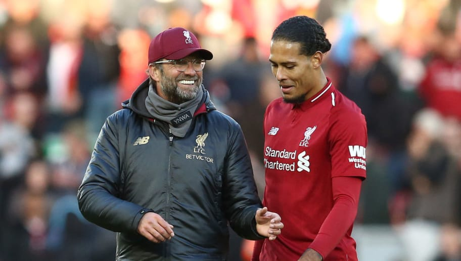 LIVERPOOL, ENGLAND - OCTOBER 27:  Jurgen Klopp, Manager of Liverpool speaks with Virgil van Dijk of Liverpool after the Premier League match between Liverpool FC and Cardiff City at Anfield on October 27, 2018 in Liverpool, United Kingdom.  (Photo by Jan Kruger/Getty Images)