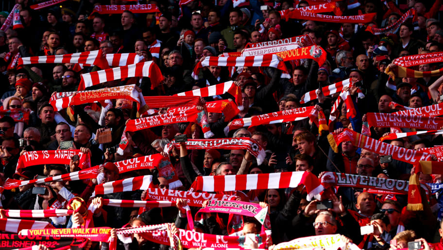 LIVERPOOL, ENGLAND - OCTOBER 27: Fans of Liverpool hold top scarves during the Premier League match between Liverpool FC and Cardiff City at Anfield on October 27, 2018 in Liverpool, United Kingdom. (Photo by Robbie Jay Barratt - AMA/Getty Images)