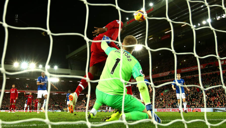 LIVERPOOL, ENGLAND - DECEMBER 02:  Divock Origi of Liverpool scores his team's first goal past Jordan Pickford of Everton during the Premier League match between Liverpool FC and Everton FC at Anfield on December 2, 2018 in Liverpool, United Kingdom.  (Photo by Clive Brunskill/Getty Images)