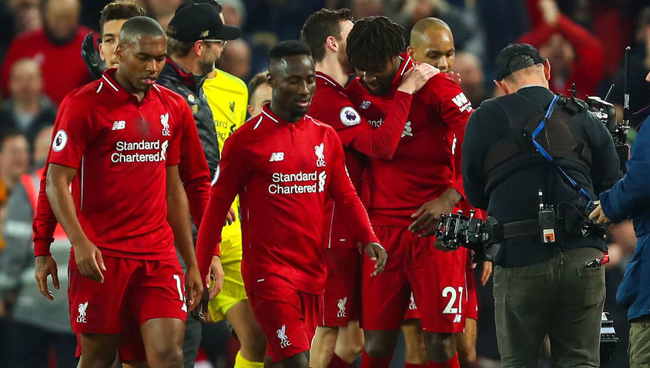 LIVERPOOL, ENGLAND - DECEMBER 02: Divock Origi of Liverpool celebrates at full time during the Premier League match between Liverpool FC and Everton FC at Anfield on December 2, 2018 in Liverpool, United Kingdom. (Photo by Robbie Jay Barratt - AMA/Getty Images)
