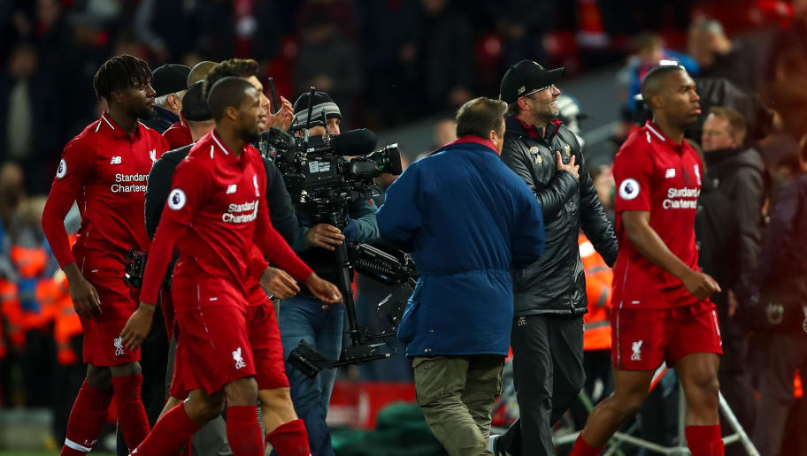 LIVERPOOL, ENGLAND - DECEMBER 02: Jurgen Klopp the manager / head coach of Liverpool celebrates as Divock Origi of Liverpool and team mates walk off at full time during the Premier League match between Liverpool FC and Everton FC at Anfield on December 2, 2018 in Liverpool, United Kingdom. (Photo by Robbie Jay Barratt - AMA/Getty Images)