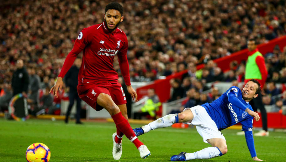 LIVERPOOL, ENGLAND - DECEMBER 02: Joe Gomez of Liverpool and Bernard of Everton during the Premier League match between Liverpool FC and Everton FC at Anfield on December 2, 2018 in Liverpool, United Kingdom. (Photo by Robbie Jay Barratt - AMA/Getty Images)