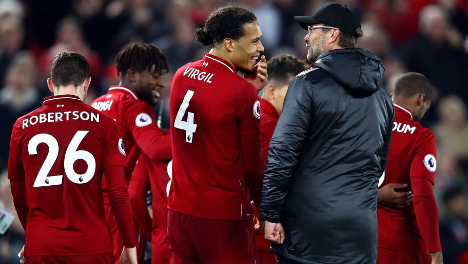 LIVERPOOL, ENGLAND - DECEMBER 02:  Jurgen Klopp, Manager of Liverpool and Virgil van Dijk of Liverpool celebrate victory following the Premier League match between Liverpool FC and Everton FC at Anfield on December 2, 2018 in Liverpool, United Kingdom.  (Photo by Clive Brunskill/Getty Images)