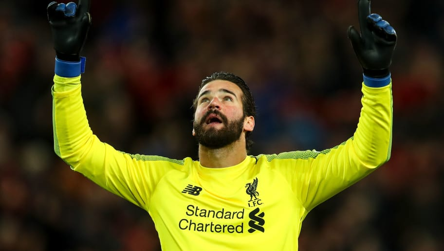 LIVERPOOL, ENGLAND - DECEMBER 02: Alisson Becker of Liverpool celebrates during the Premier League match between Liverpool FC and Everton FC at Anfield on December 2, 2018 in Liverpool, United Kingdom. (Photo by Robbie Jay Barratt - AMA/Getty Images)