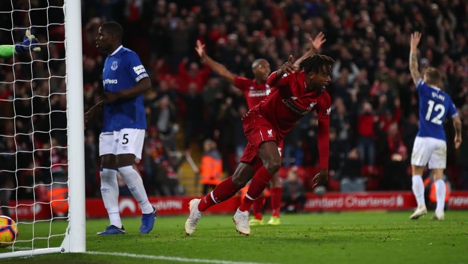 LIVERPOOL, ENGLAND - DECEMBER 02: Divock Origi of Liverpool celebrates after scoring his team's first goal during the Premier League match between Liverpool FC and Everton FC at Anfield on December 02, 2018 in Liverpool, United Kingdom. (Photo by Clive Brunskill/Getty Images)
